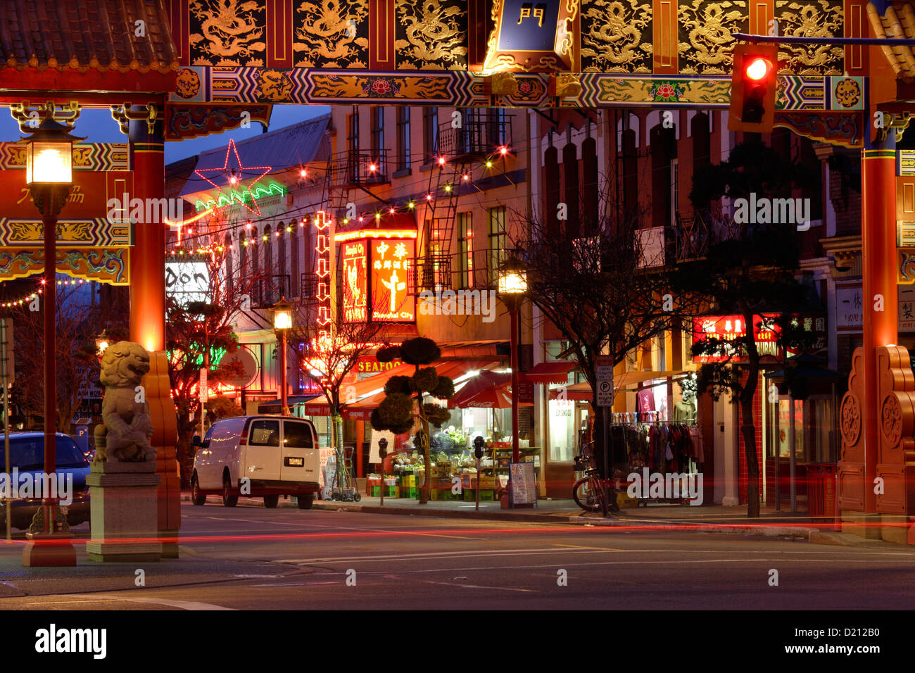 Gate of Harmonious Interest in Canada's oldest Chinatown at dusk-Victoria, British Columbia, Canada. - Stock Image