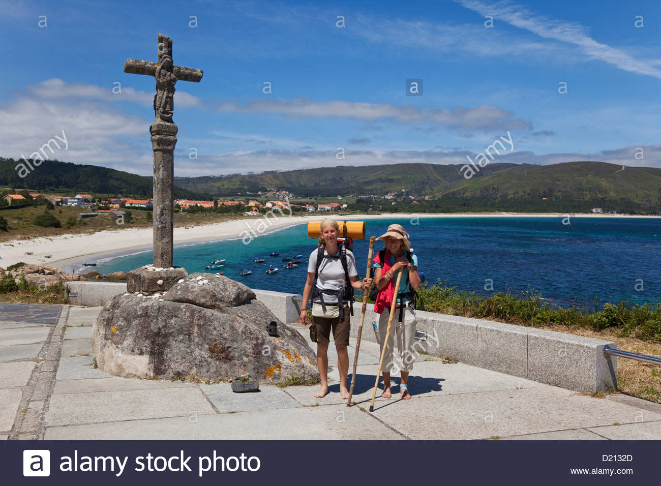 Pilgrims on the Camino de Santiago, the final destination is Finisterre, where some pilgrim burn all their clothes - Stock Image