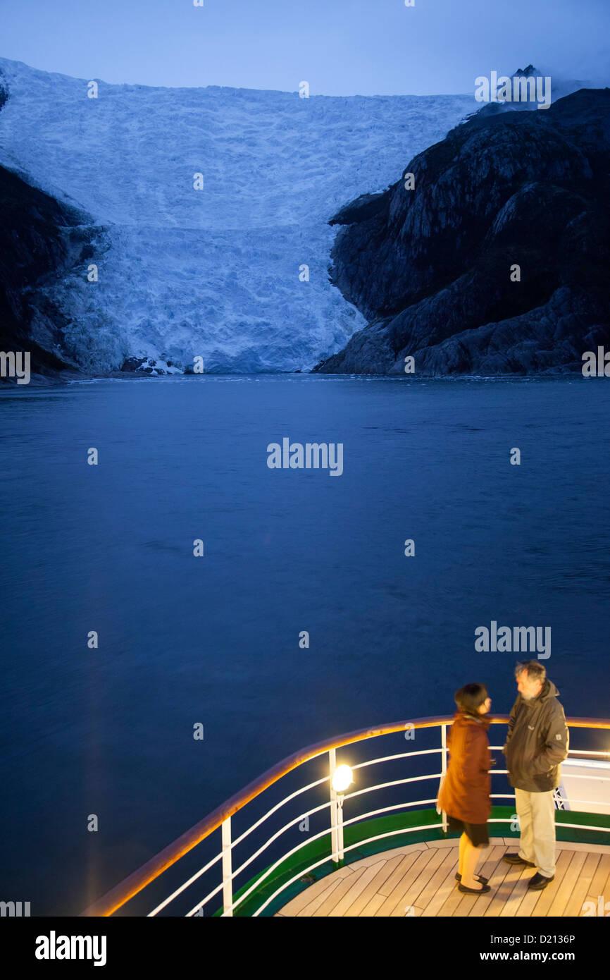 Couple on deck of cruise ship MS Deutschland, Reederei Peter Deilmann, near terminal of Italian Glacier, Chilean - Stock Image
