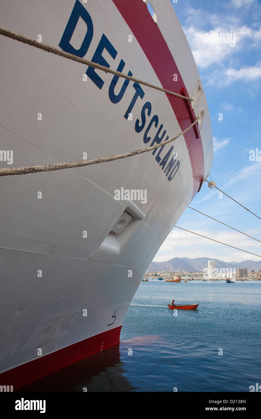 Cruise ship MS Deutschland, Reederei Peter Deilmann and fishing dinghy, Coquimbo, Chile, South America Stock Photo