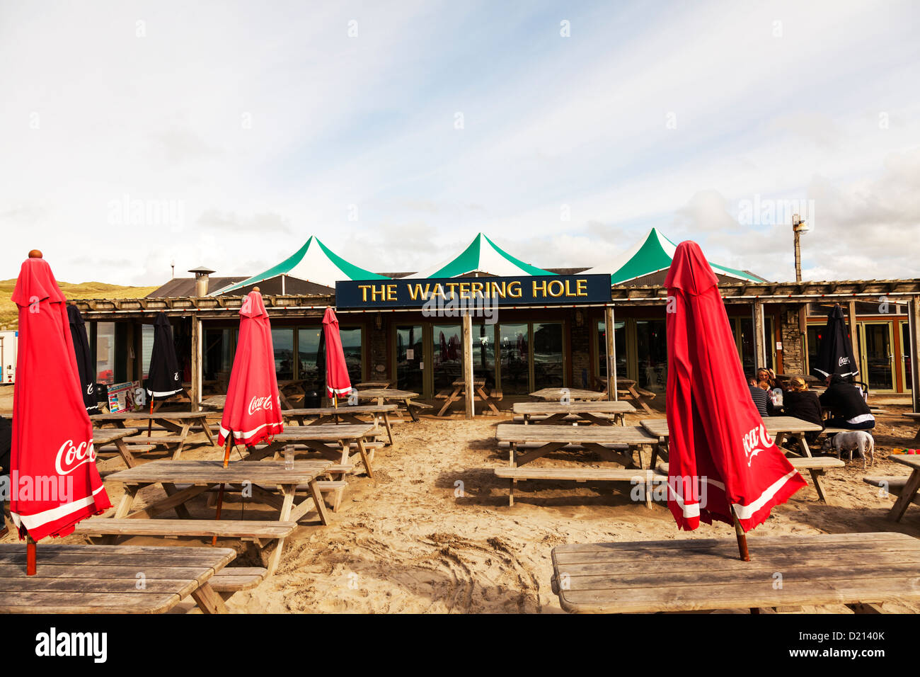 Perranporth Perrenporth, The Watering Hole Bar, Cornwall, UK, England outside tables and umbrellas exterior of building - Stock Image