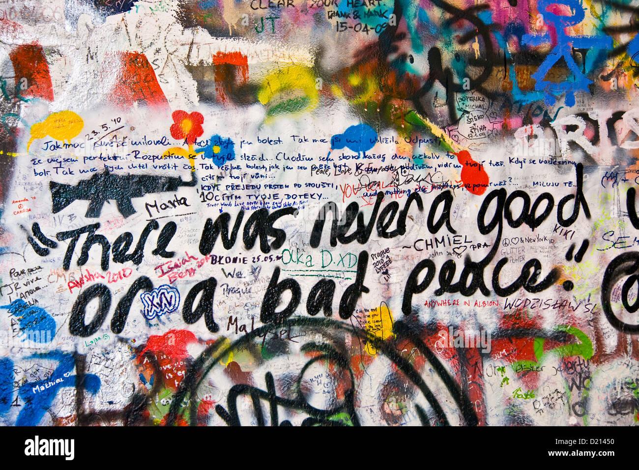 Urban graffiti street art slogan words on John Lennon Wall Prague Czech Republic Europe - Stock Image