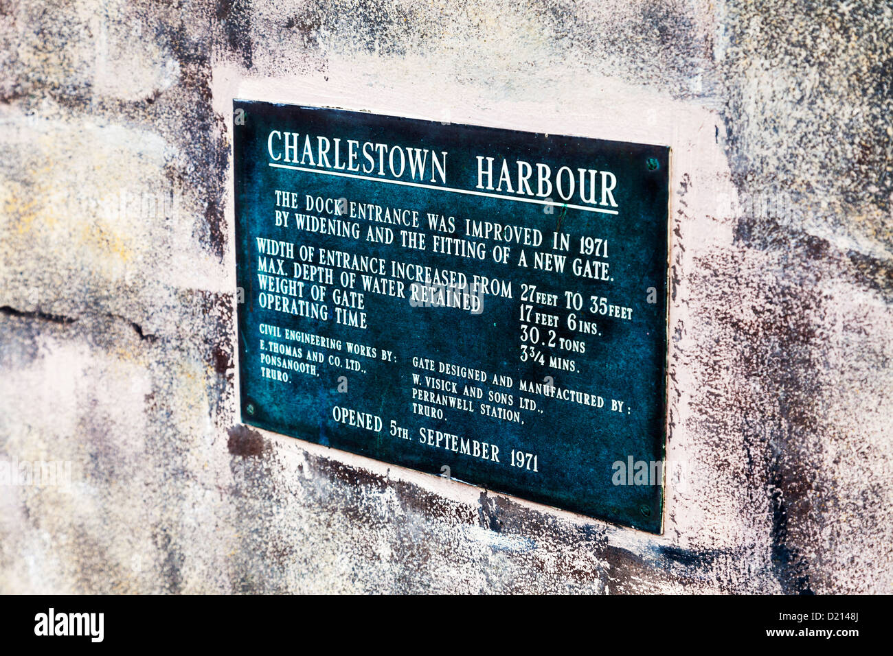 Plaque on wall at Charlestown, Cornwall small village with iconic boats in harbour - Stock Image