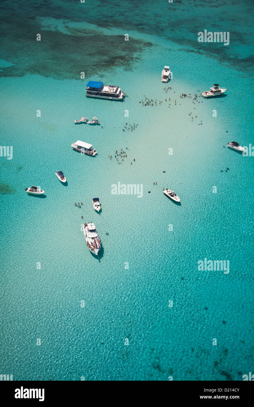 Aerial view of Stingray City sand bank with excursion boats and people swimming, Grand Cayman, Cayman Islands, Caribbean - Stock Image