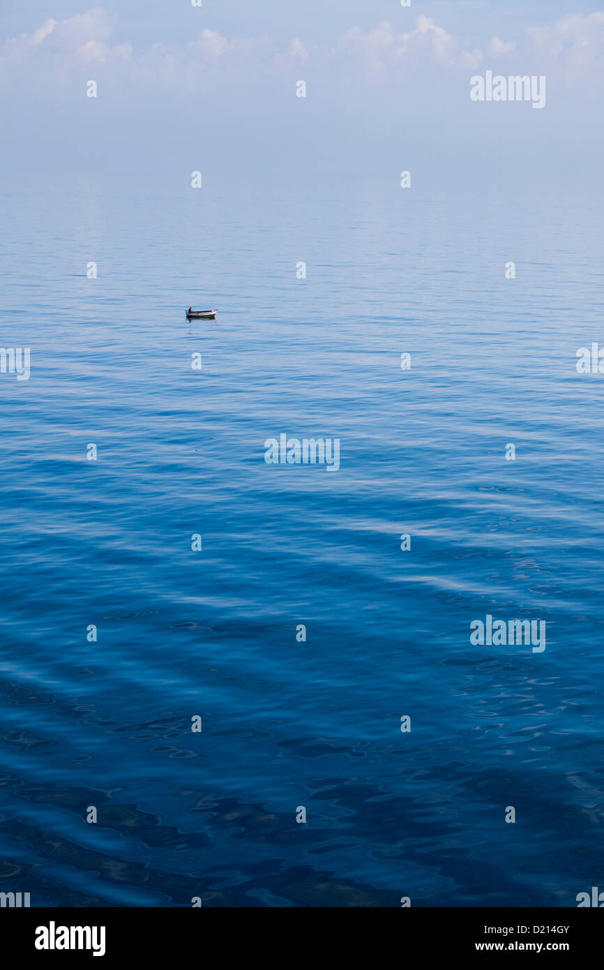 Small fishing boat in the deep blue sea, Havana, Havana, Cuba, Caribbean Stock Photo