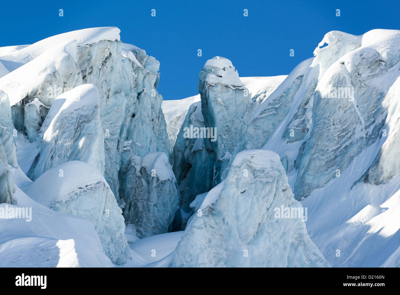 glacial crevasse and ice structures in a glacier above saas fee, valais, switzerland - Stock Image
