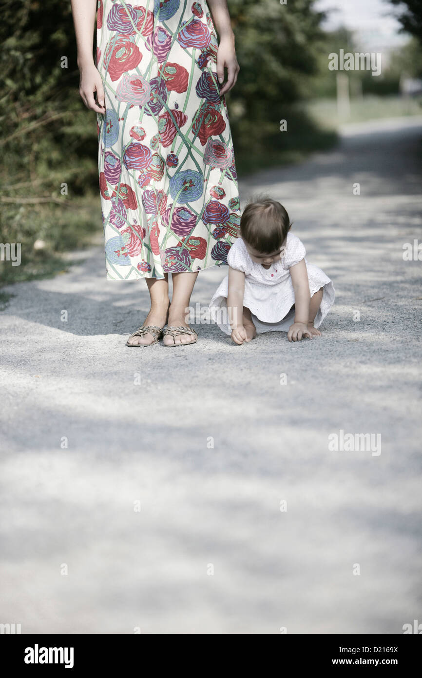 Baby girl playing on graveled path, Old Danube, Vienna, Austria - Stock Image