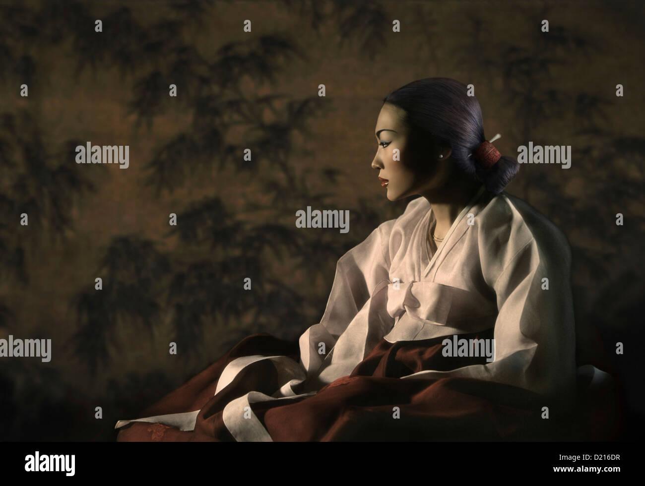 Young woman in a traditional Korean hanbok dress, Seoul, South Korea, Asia - Stock Image