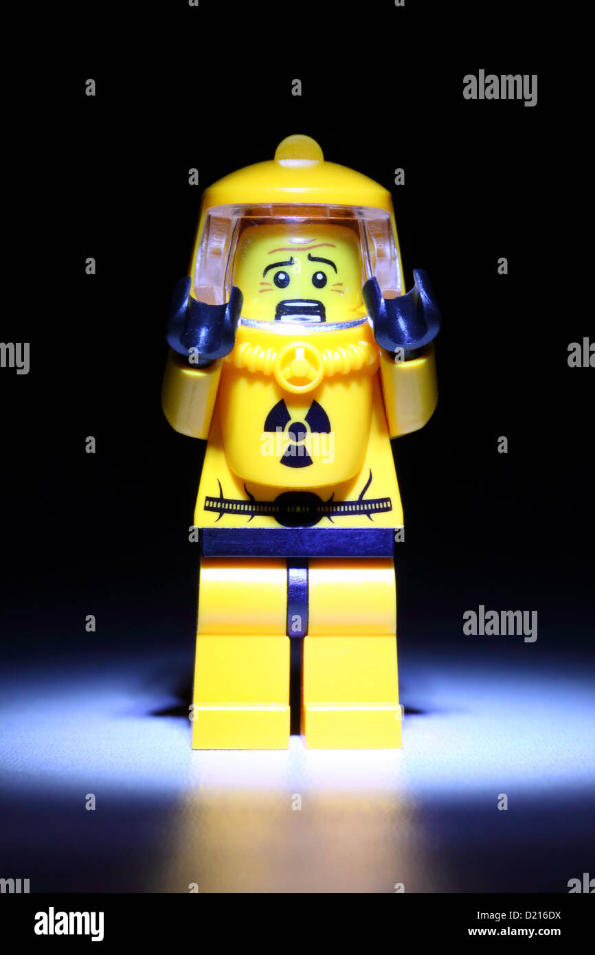 Scared Lego technician in hazmat suit - Stock Image