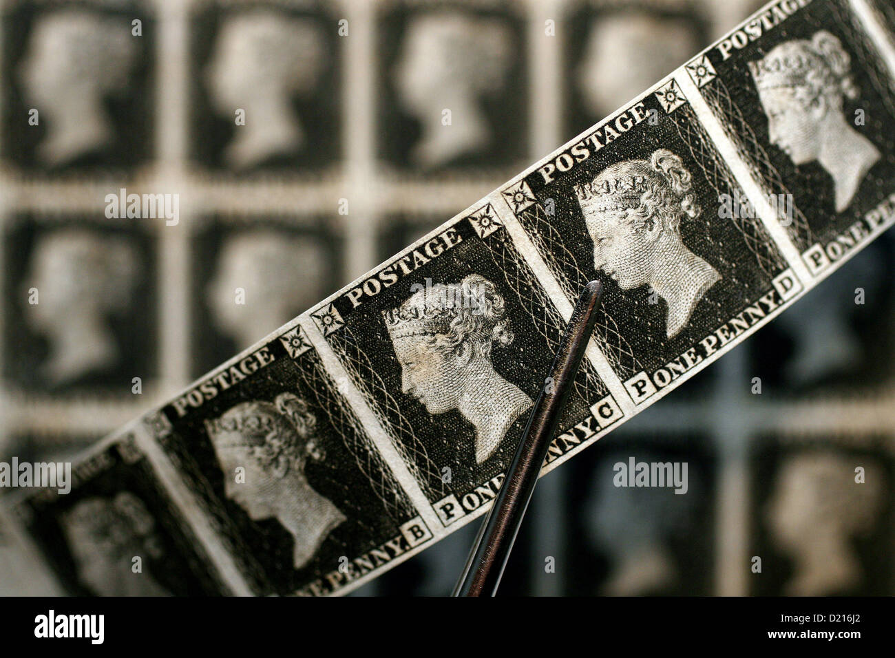 Rare collection of mint condition Penny Blacks dated 1841. The British Stamps were expected to fetch up to £2 - Stock Image
