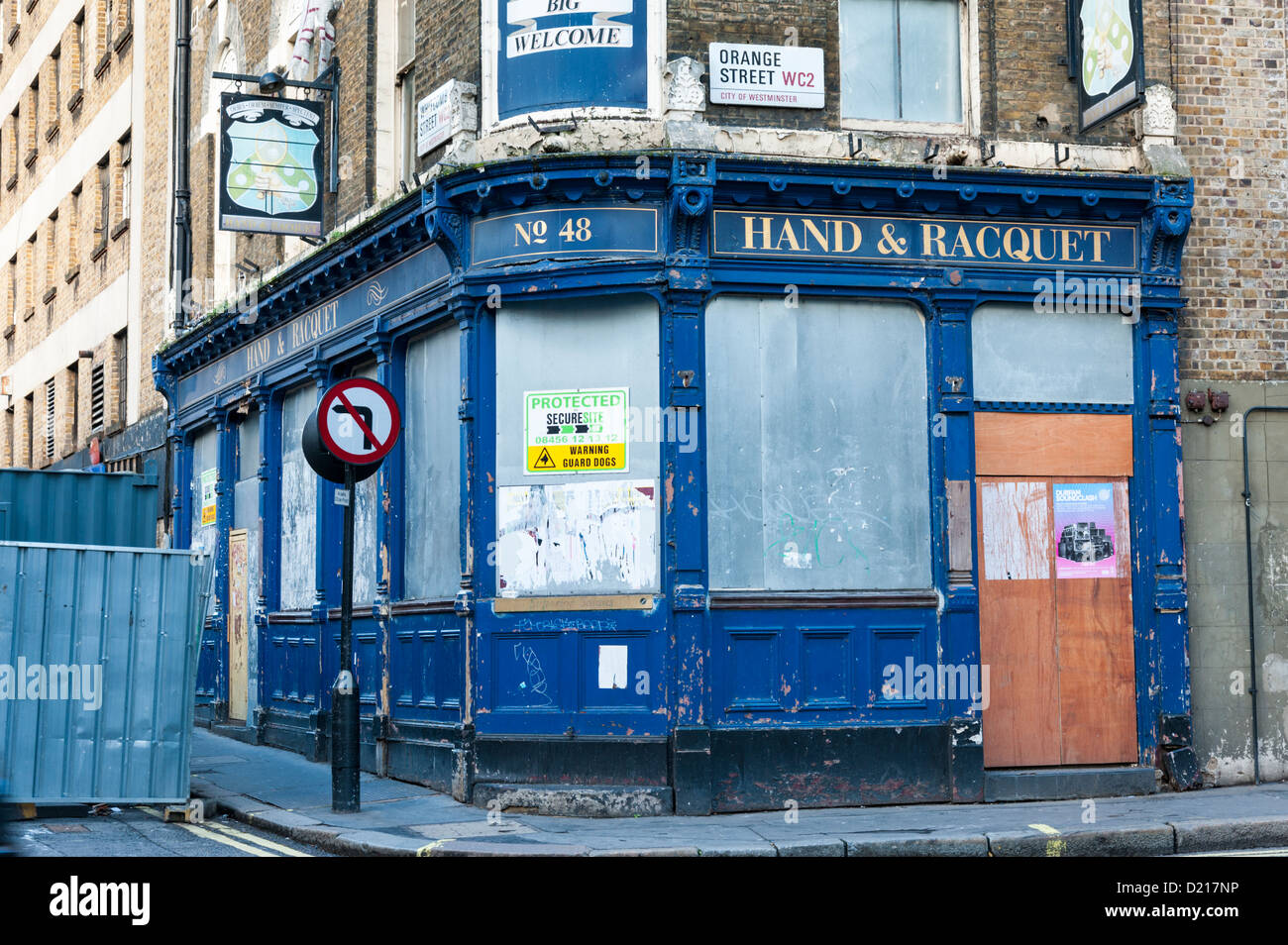 The disused Hand and Racquet pub building Orange Street and Wardour Street London UK - Stock Image