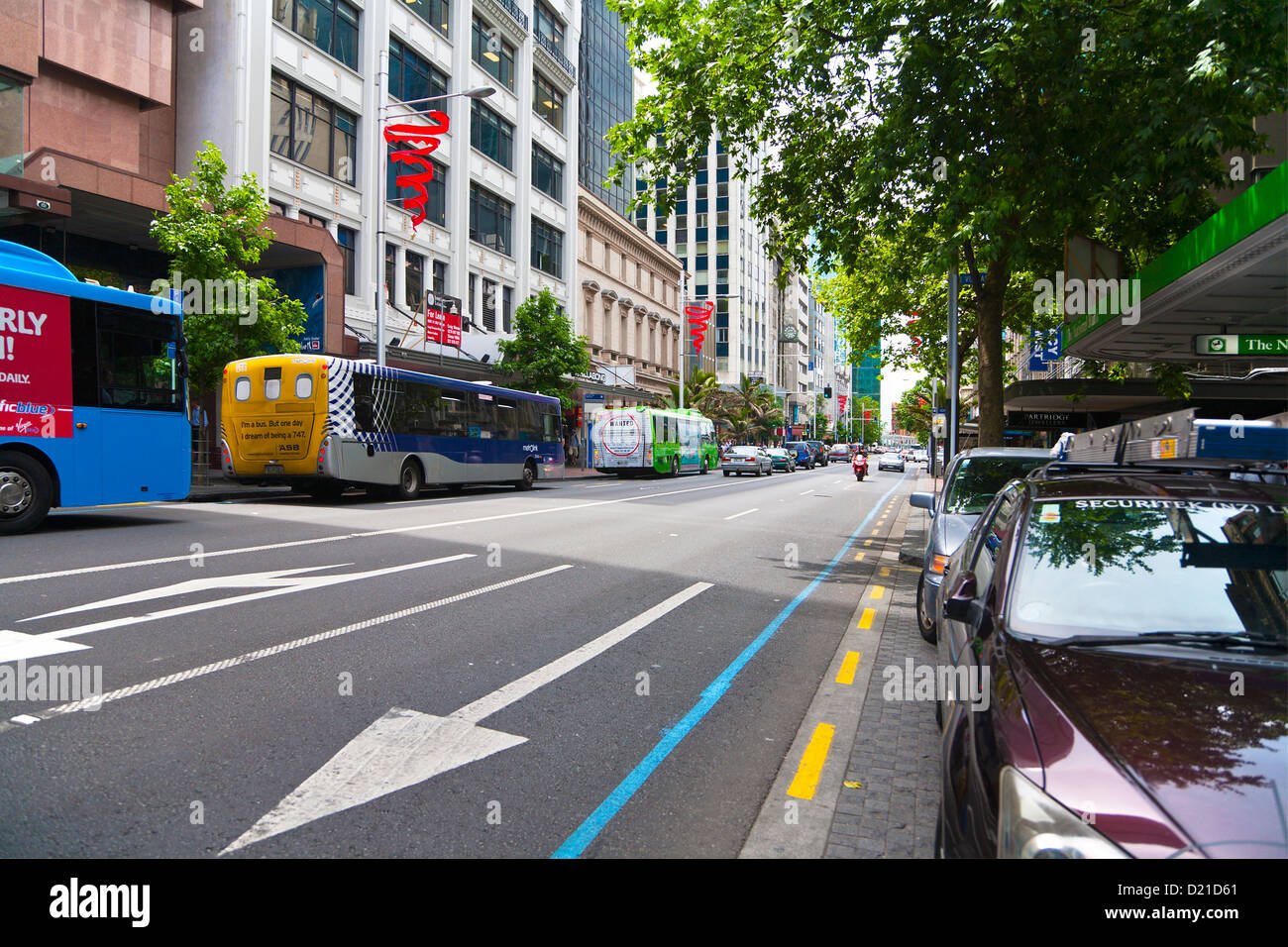 Coaches and cars parked in a street in Auckland City, North Island, New Zealand. - Stock Image