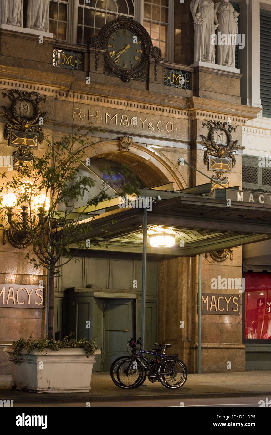 Side entrance of the R. H. Macy & Co. Inc. at night on 34th Street in Manhattan, New York City - Stock Image