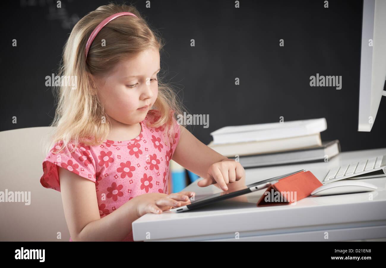 Young girl using iPad - Stock Image