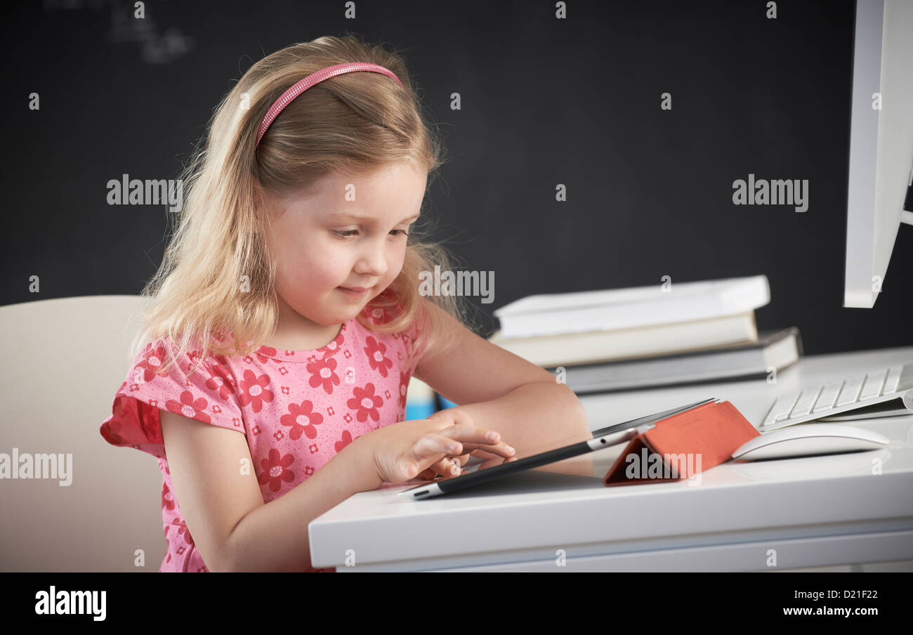 Young girl using iPad Stock Photo
