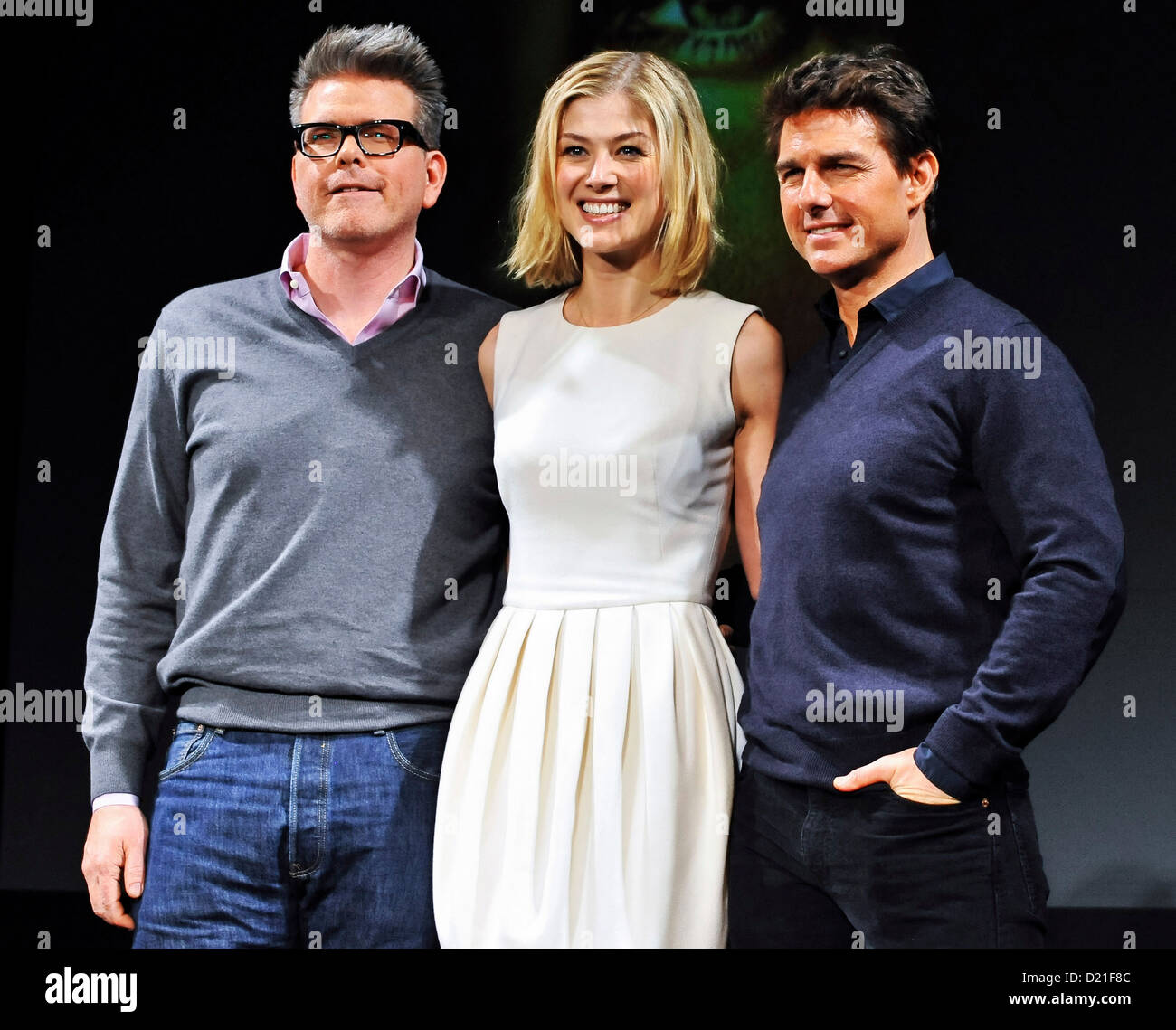 Director Christopher McQuarrie, actress Rosamund Pike and actor Tom Cruise attend the 'Jack Reacher' press - Stock Image