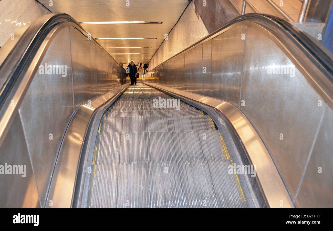 Two people ride an escalator in New York, USA, 08 January 2013. Now it is 120 years old. Photo: 08 January 2013. - Stock Image