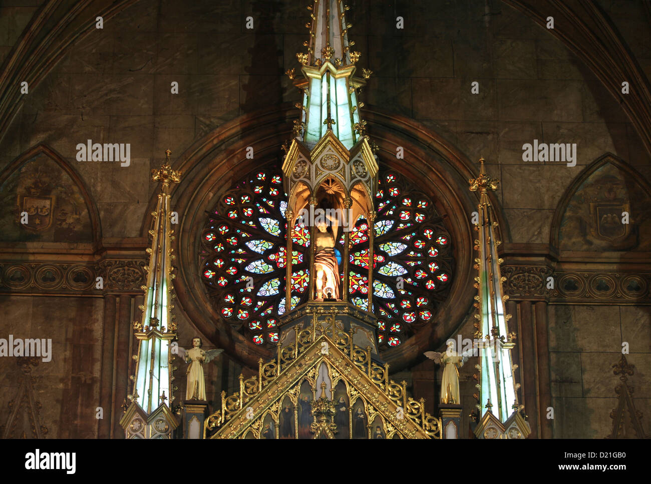 Statue and old painted glass window in Basilica de San Sebastian, the only all steel church in Asia, Manila, Philippines, - Stock Image