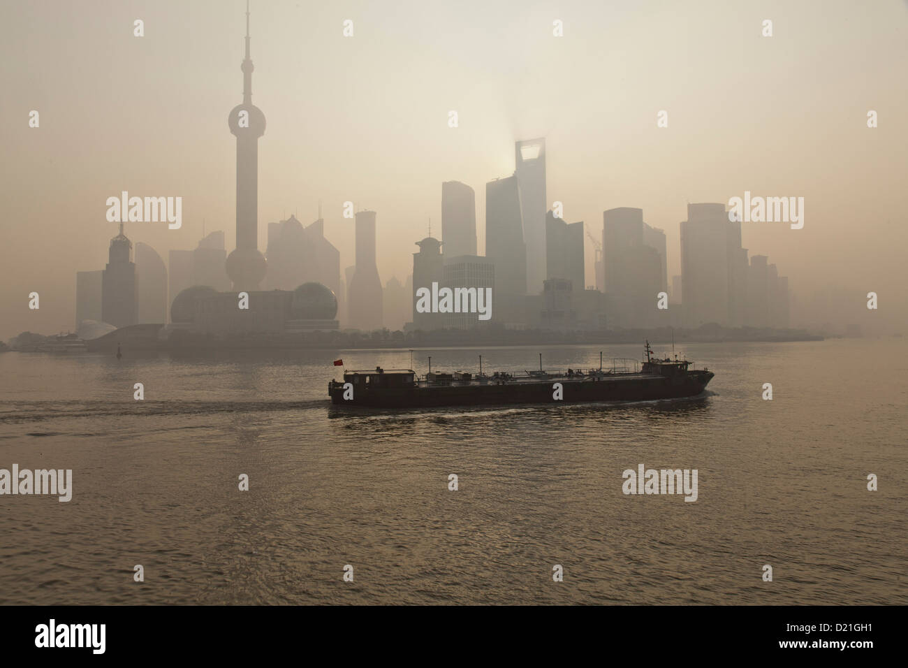 Skyline of Pudong and freighter on Huangpu River at dawn, Pudong, Shanghai, China, Asia Stock Photo