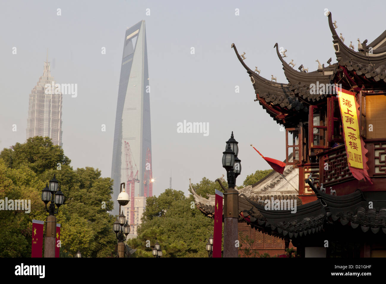 View of Huxinting Teahouse at Yu Yuan Garden and World Financial Center, Shanghai, China, Asia - Stock Image
