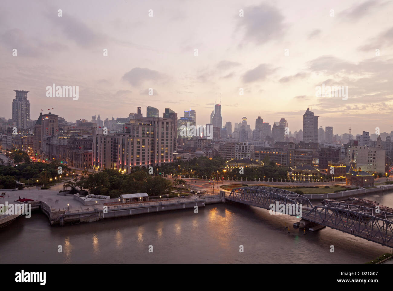 View of Waibaidu Bridge over the Huagpu River and houses of Bund in the evening, Shanghai, China, Asia Stock Photo