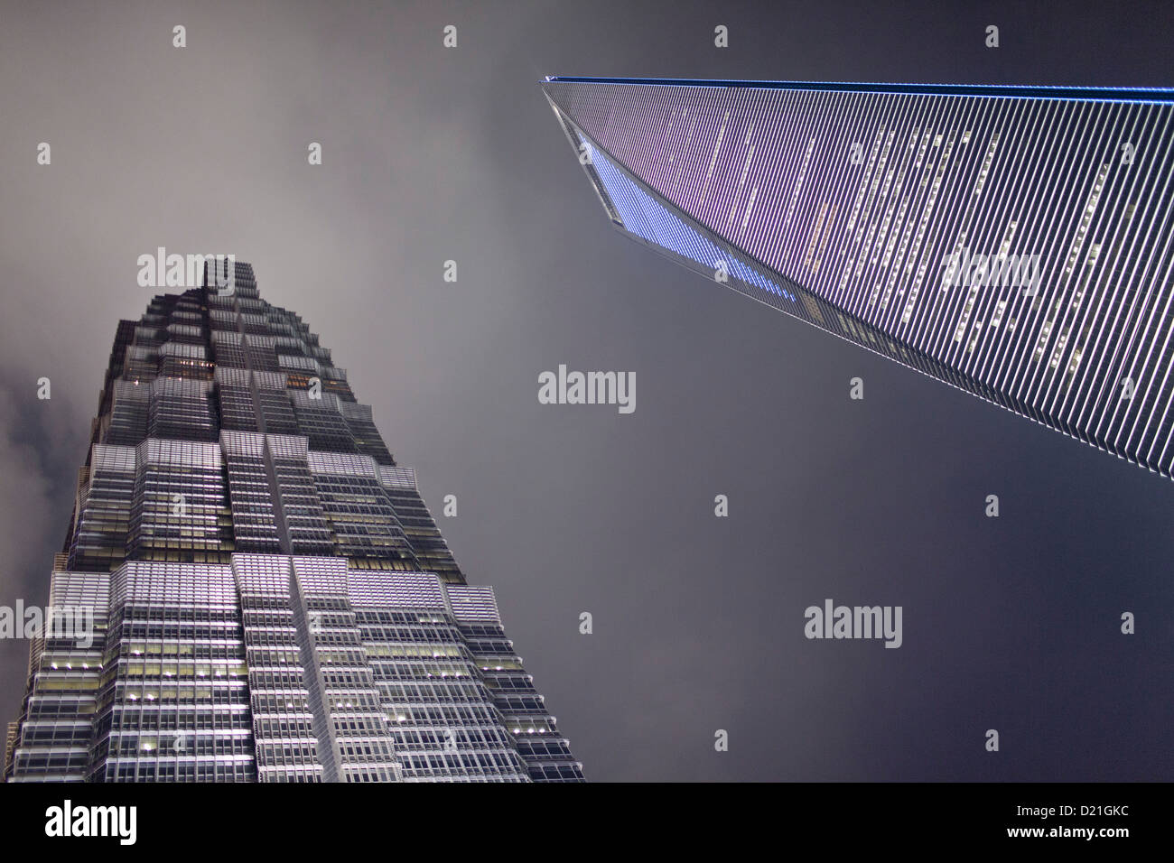 Low angle view of Shanghai World Financial Center and Jin Mao Tower at night, Pudong, Shanghai, China, Asia - Stock Image