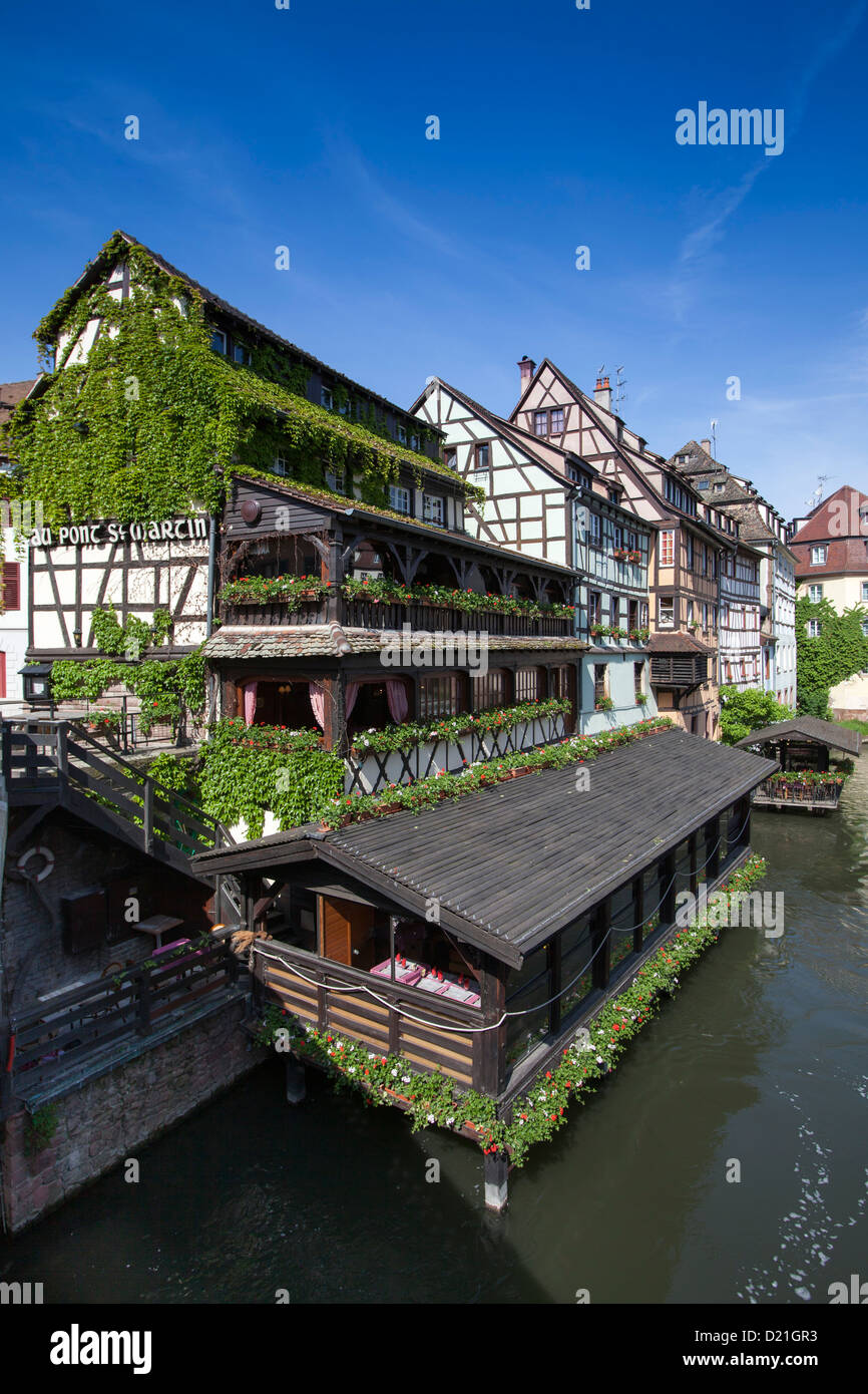 Restaurant Au Pont St. Martin and half timbered houses along the canal in La Petite France district, Strasbourg, - Stock Image