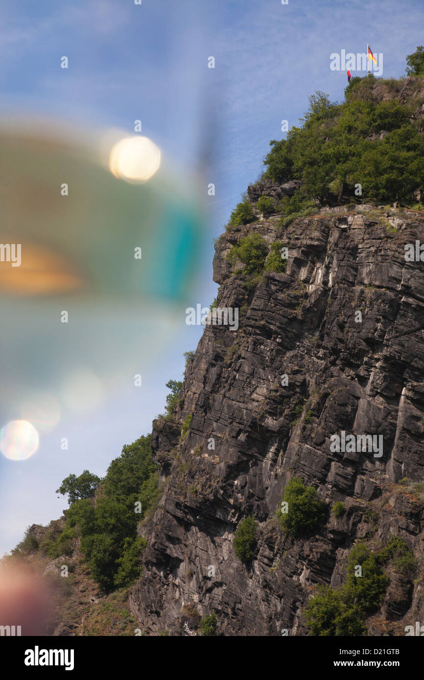 The Loreley Rock and a glass of wine seen from Rhine river cruise ship MS Bellevue, Sankt Goarshausen, Rhineland Stock Photo