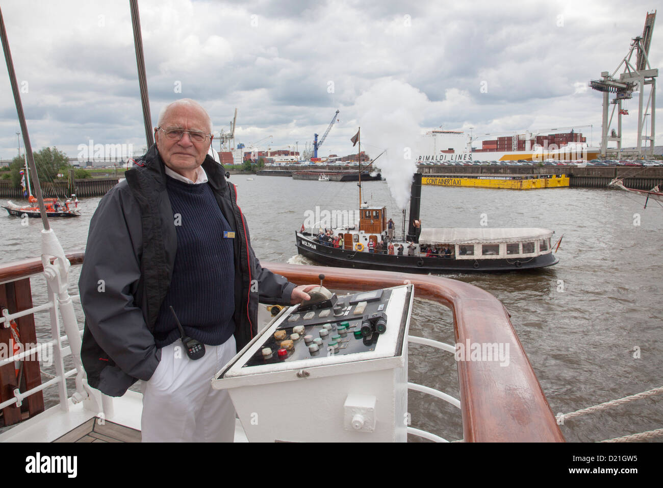 Captain Klaus Mueller maneuvers sailing cruise ship Star Flyer on Elbe river as part of Hamburg harbor birthday - Stock Image
