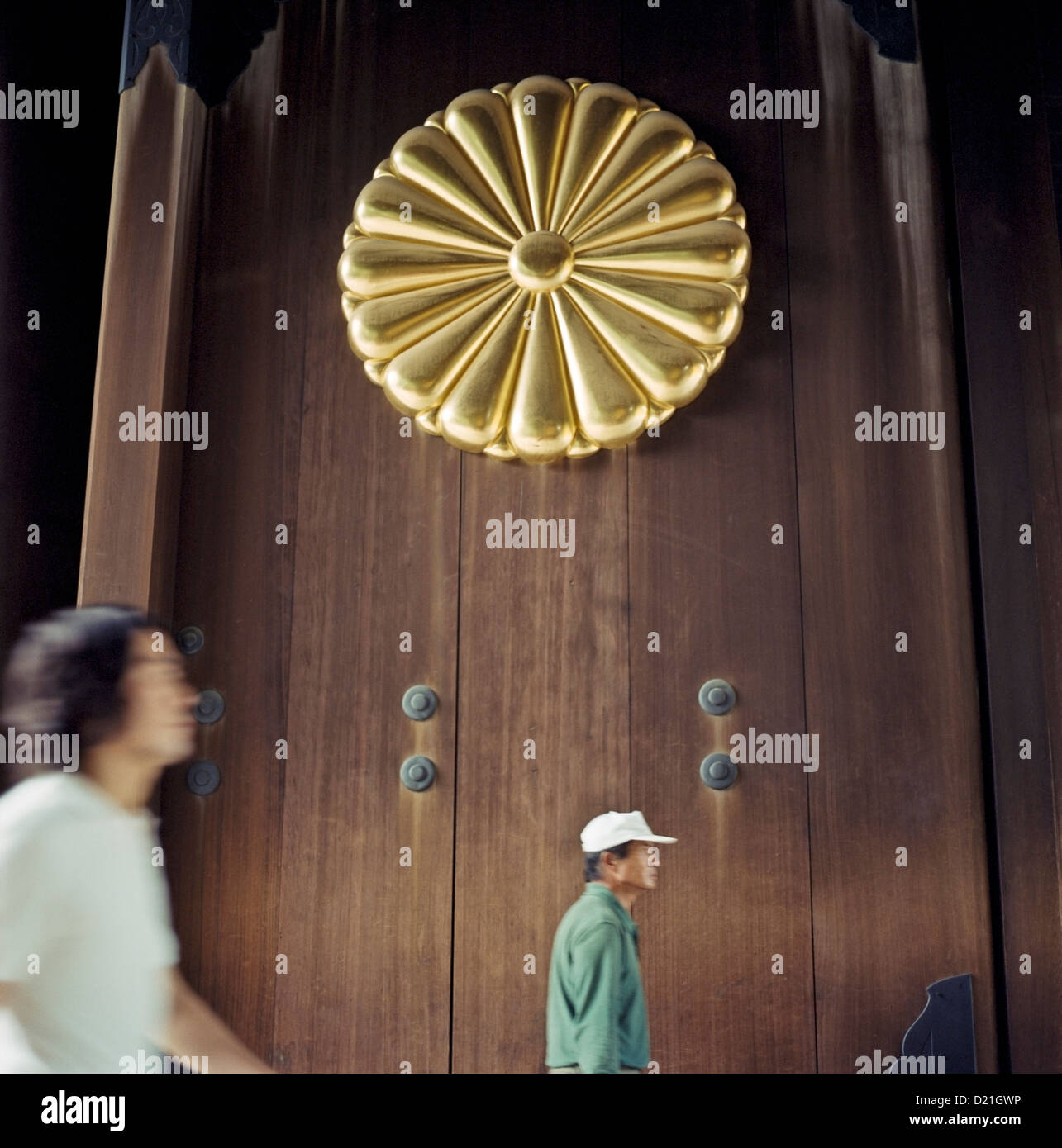 Visitors enter through the main gate at the Yasukuni Shrine in Tokyo, Japan - Stock Image