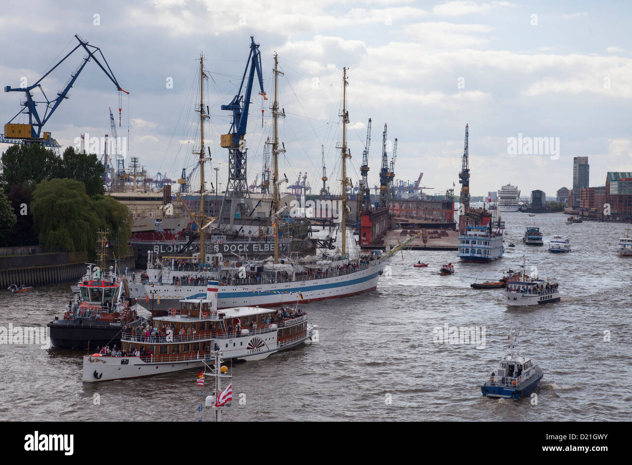 Windjammer tall sailing ship Krusenstern with other ships and boats on Elbe river as part of Hamburg harbour birthday - Stock Image
