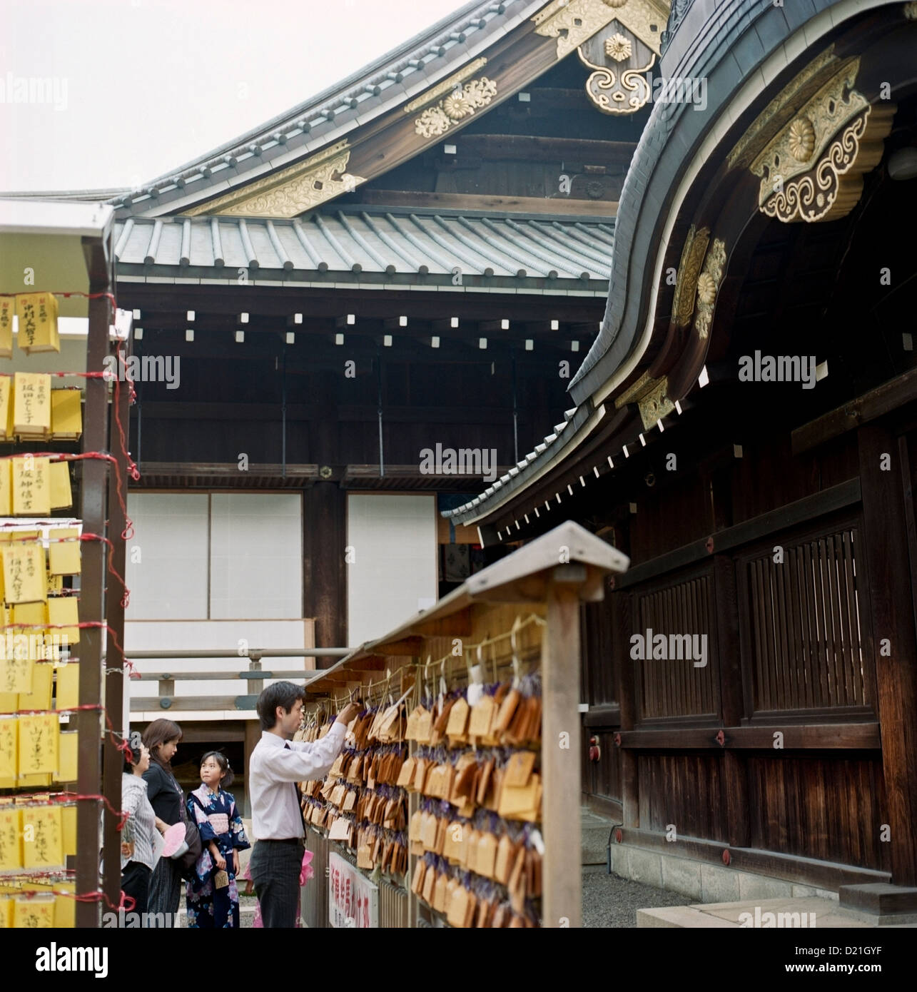 A man and his family place a prayer tablets at the Yasukuni Shrine in Tokyo, Japan - Stock Image