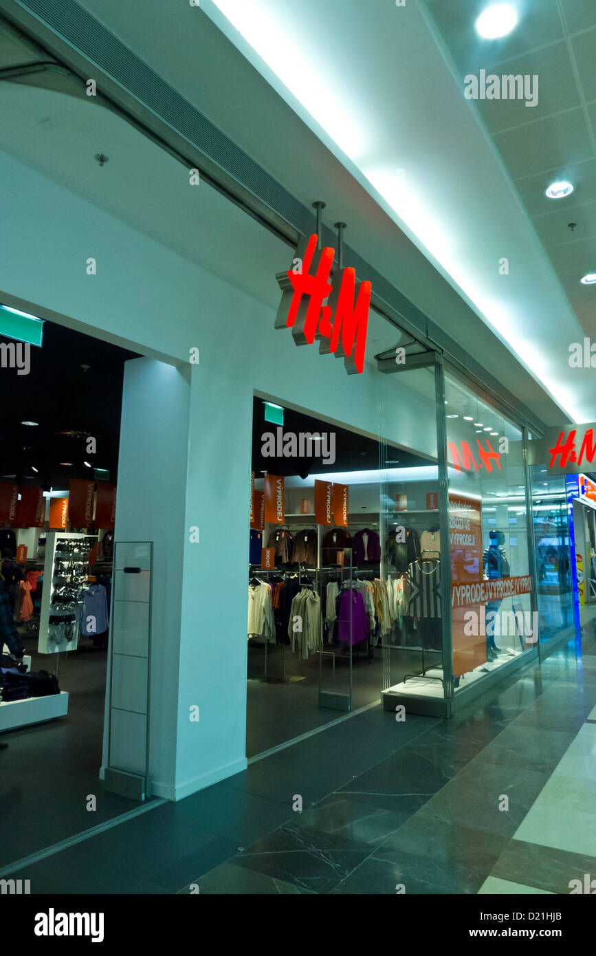 H&M store entrance and logo - Stock Image