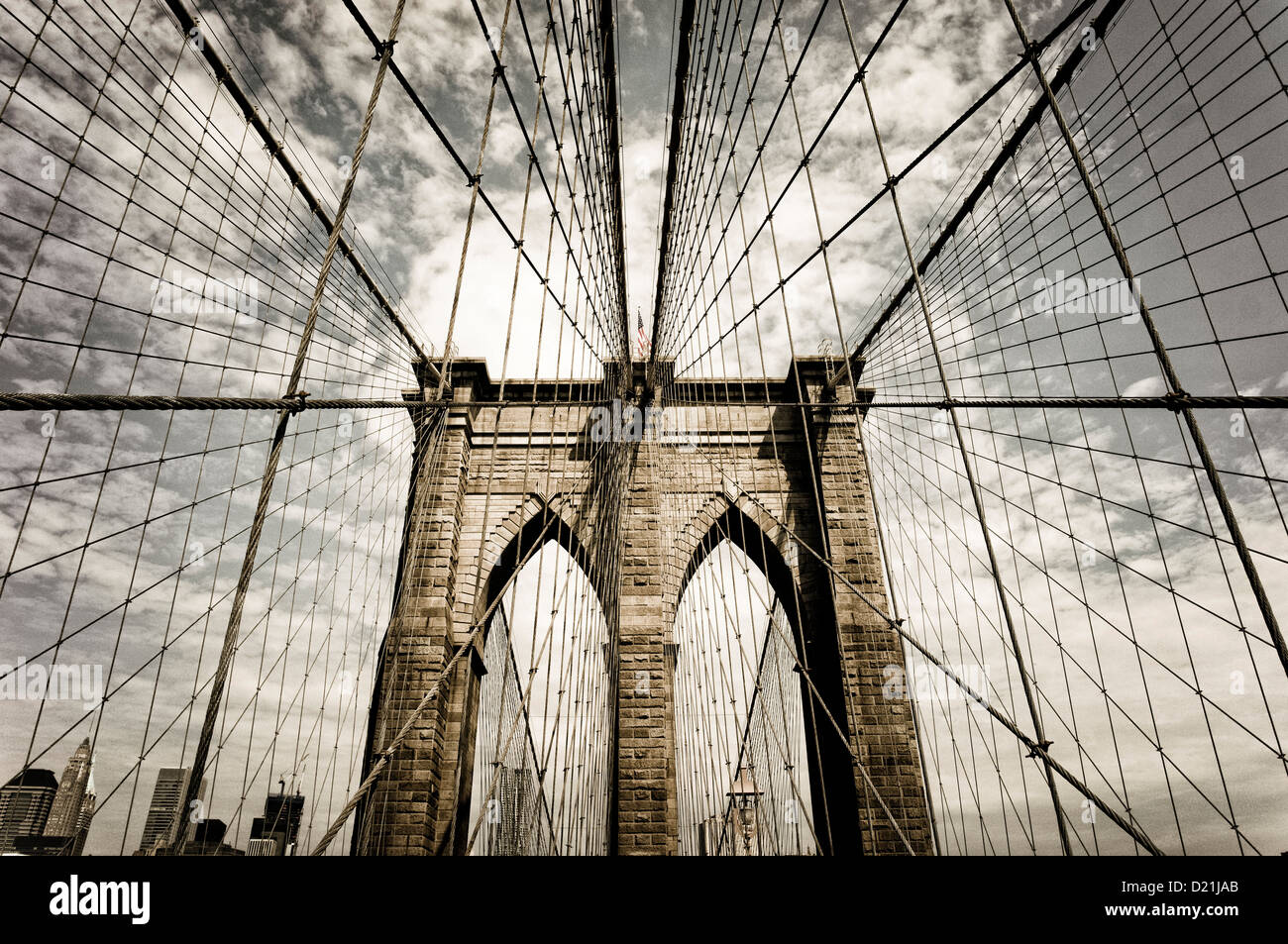 Brooklyn bridge with the sky in Sepia, New York City, New York, USA - Stock Image