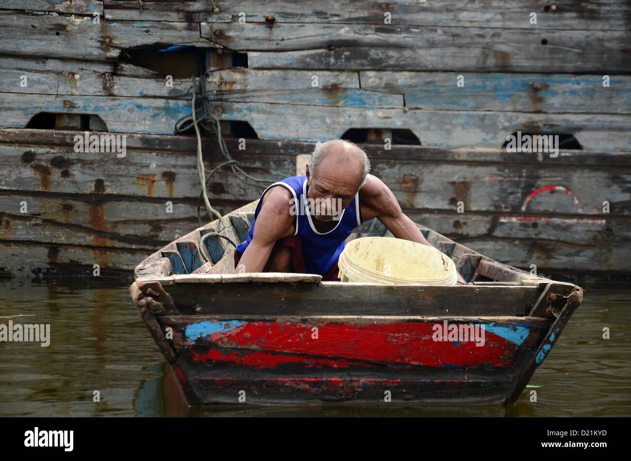 Old man and his boat - Stock Image
