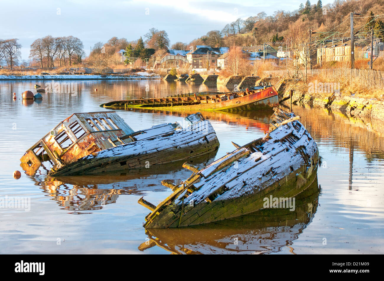 Sunken fishing boats lined up in the scottish harbour at Bowling. - Stock Image