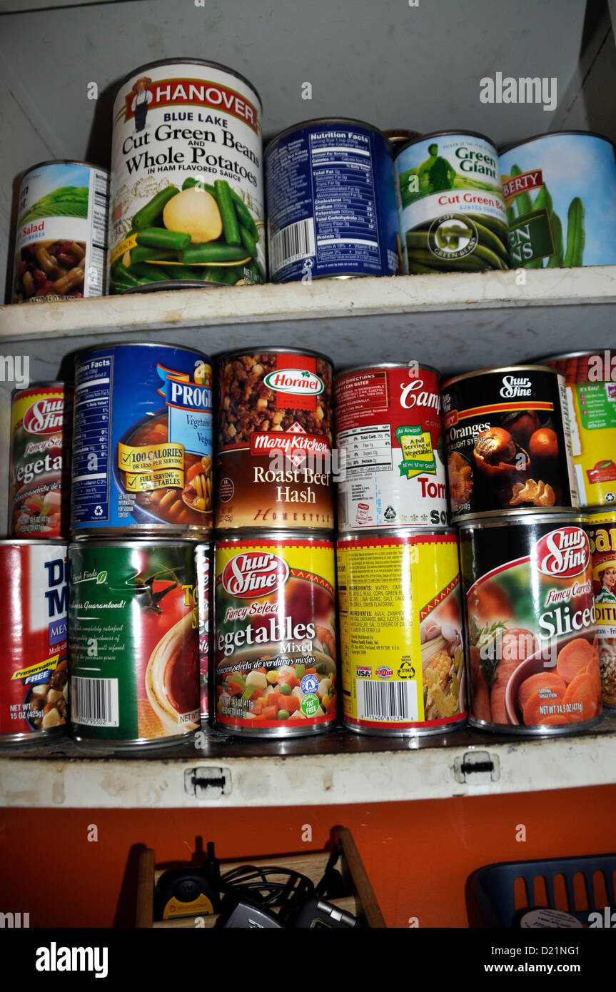 canned food on a shelf - Stock Image