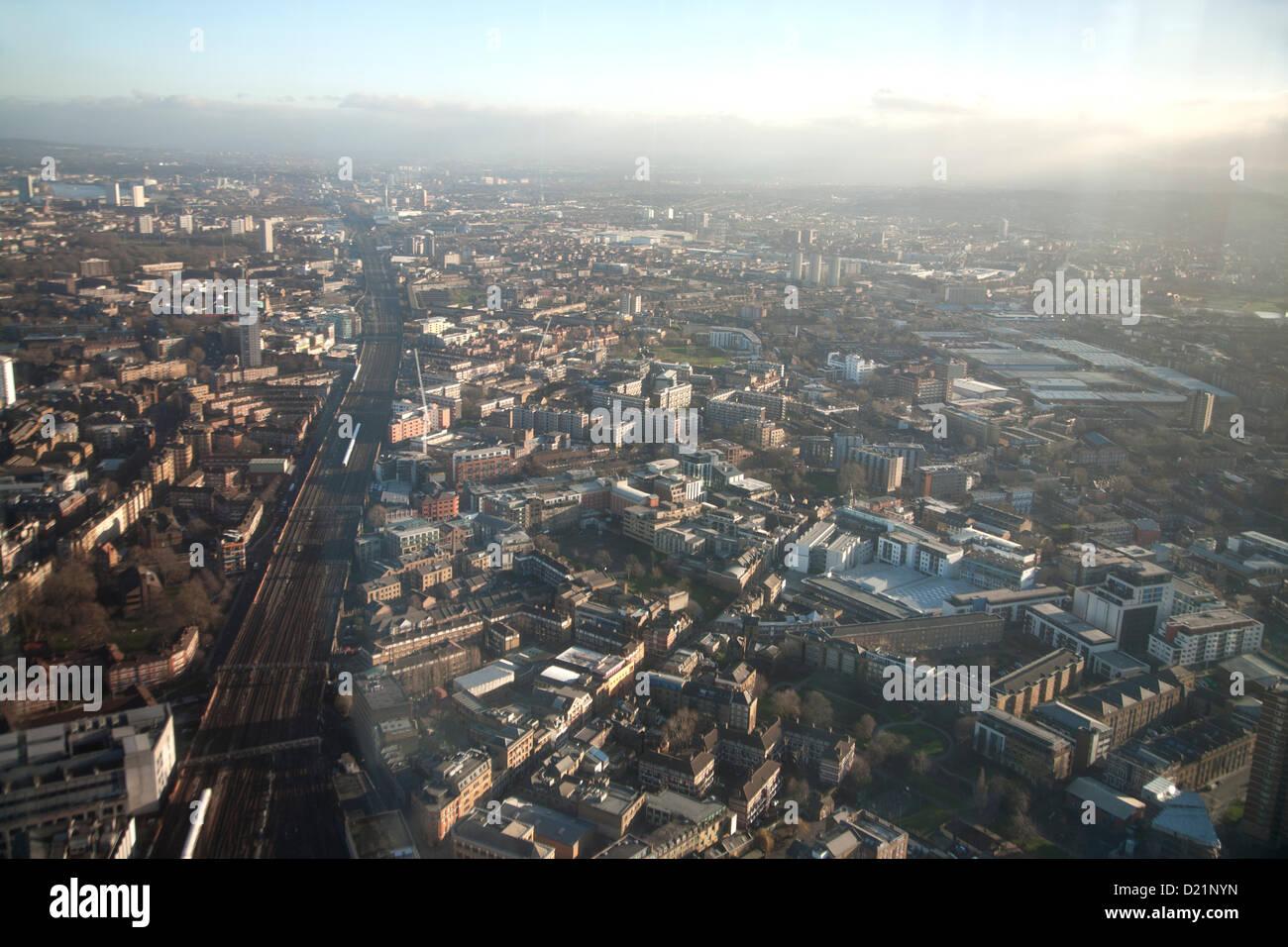 London, UK. The View from the Shard, towards Bermondsey including, the River Thames, railtracks leaving London Bridge - Stock Image
