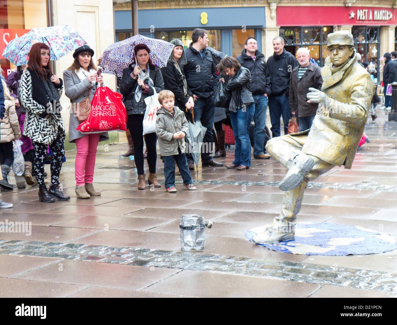 Busker balancing illusion. Bath England - Stock Image