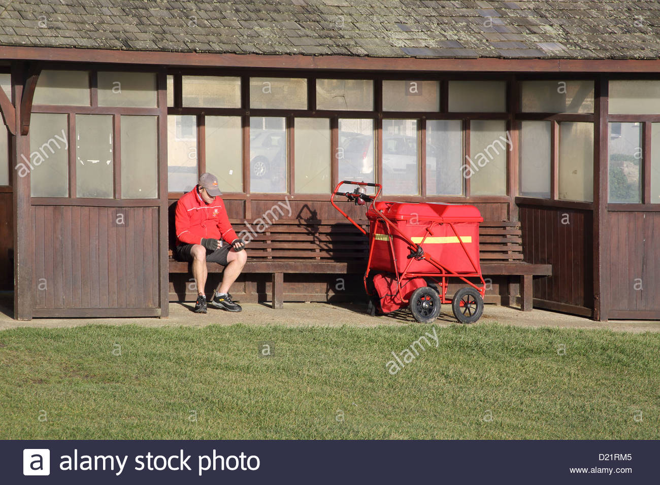 postman taking a break in hampshire - Stock Image
