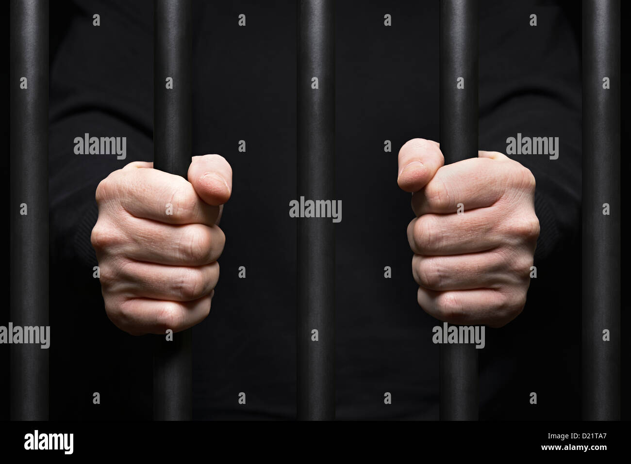 Prisoner Behind Bars. Close Up. - Stock Image