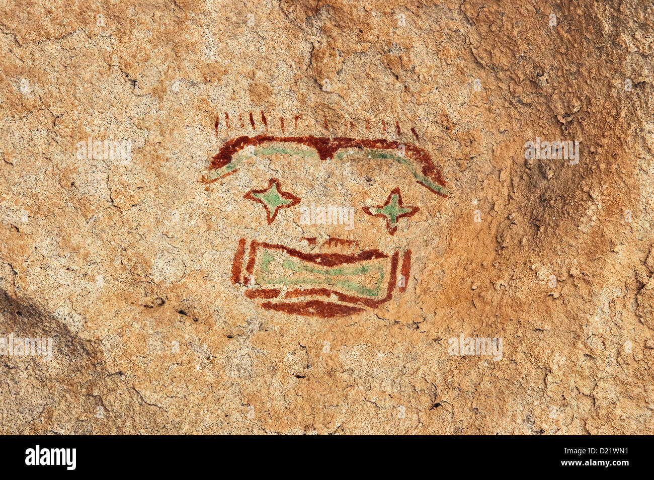 Starry-Eyed Man, red-and-green mask pictograph, by Jornada Mogollon peoples, Hueco Tanks State Park and Historic - Stock Image