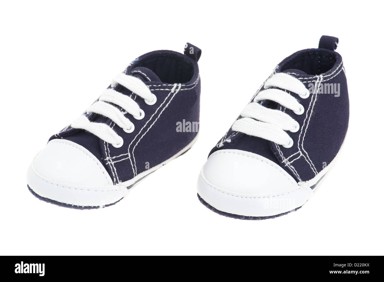 Little boys blue denim baby shoes - studio shot with a white background - Stock Image