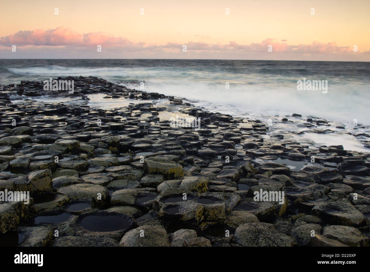 Morning light and strong waves on the Giant's Causeway - landmark of Northern Ireland Stock Photo