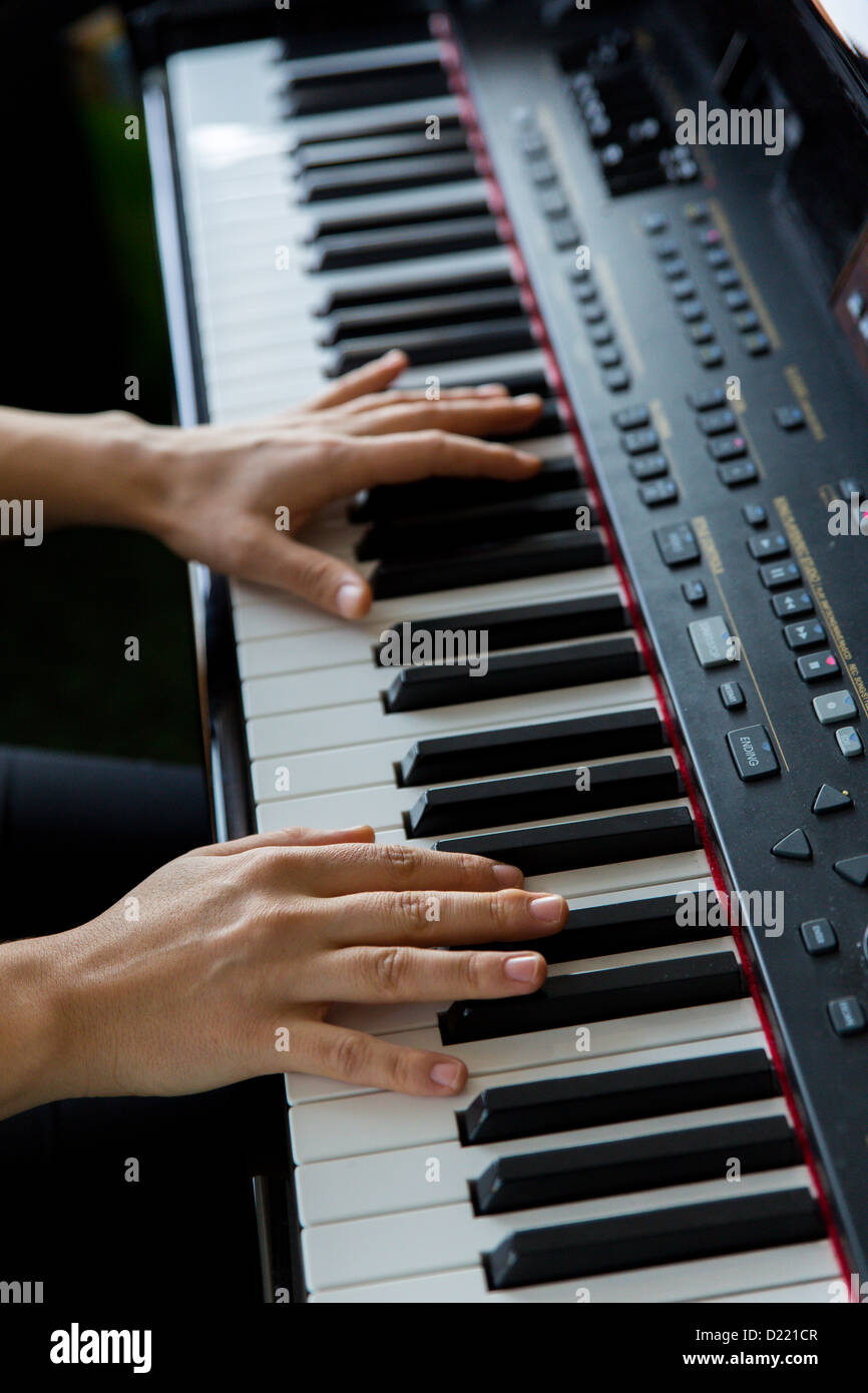 Hands playing electric keyboard - Stock Image