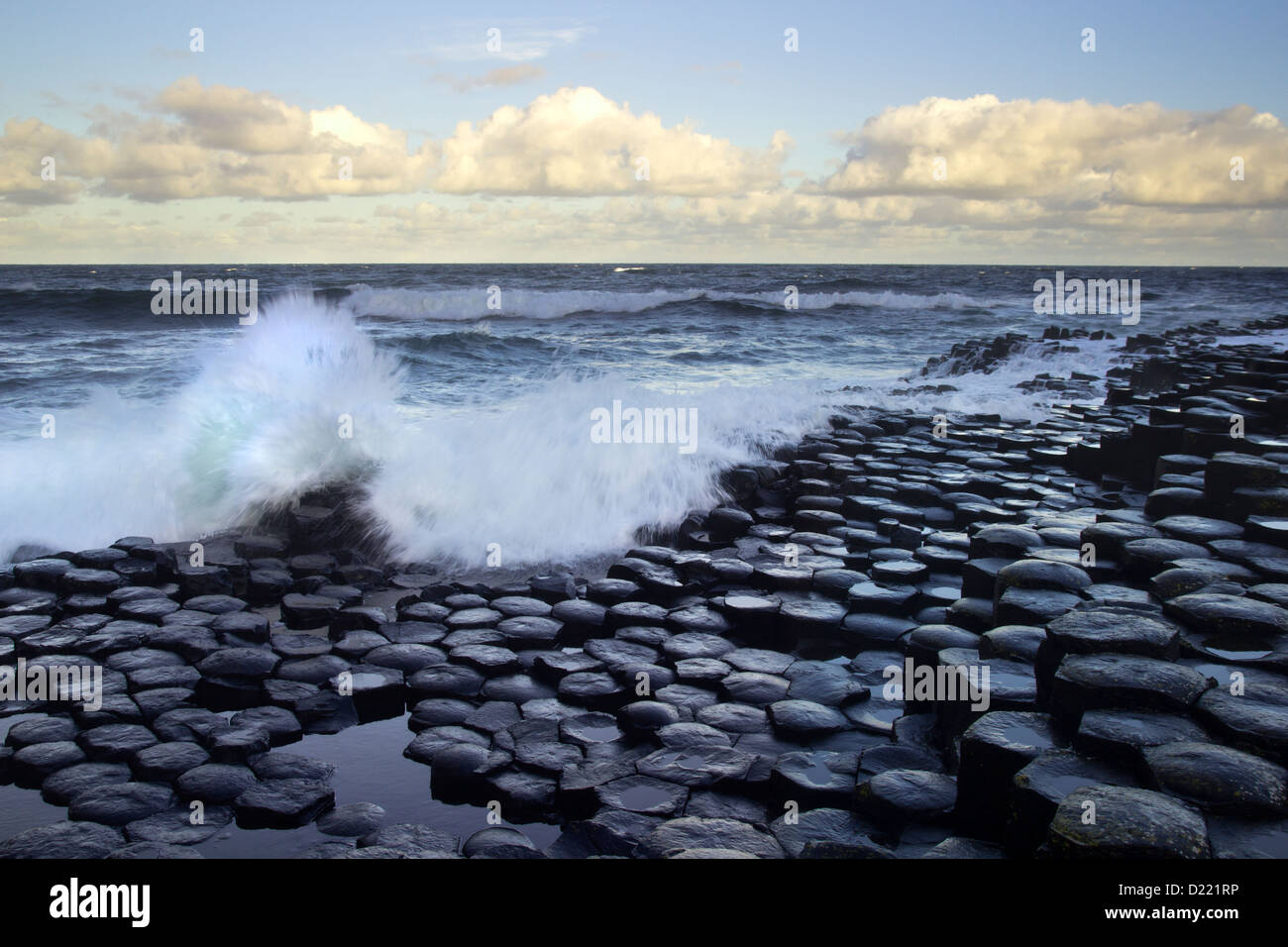 Waves splashing on the great hexagon stones of the Giant's Causeway from the Antrim coast, Northern Ireland. Stock Photo