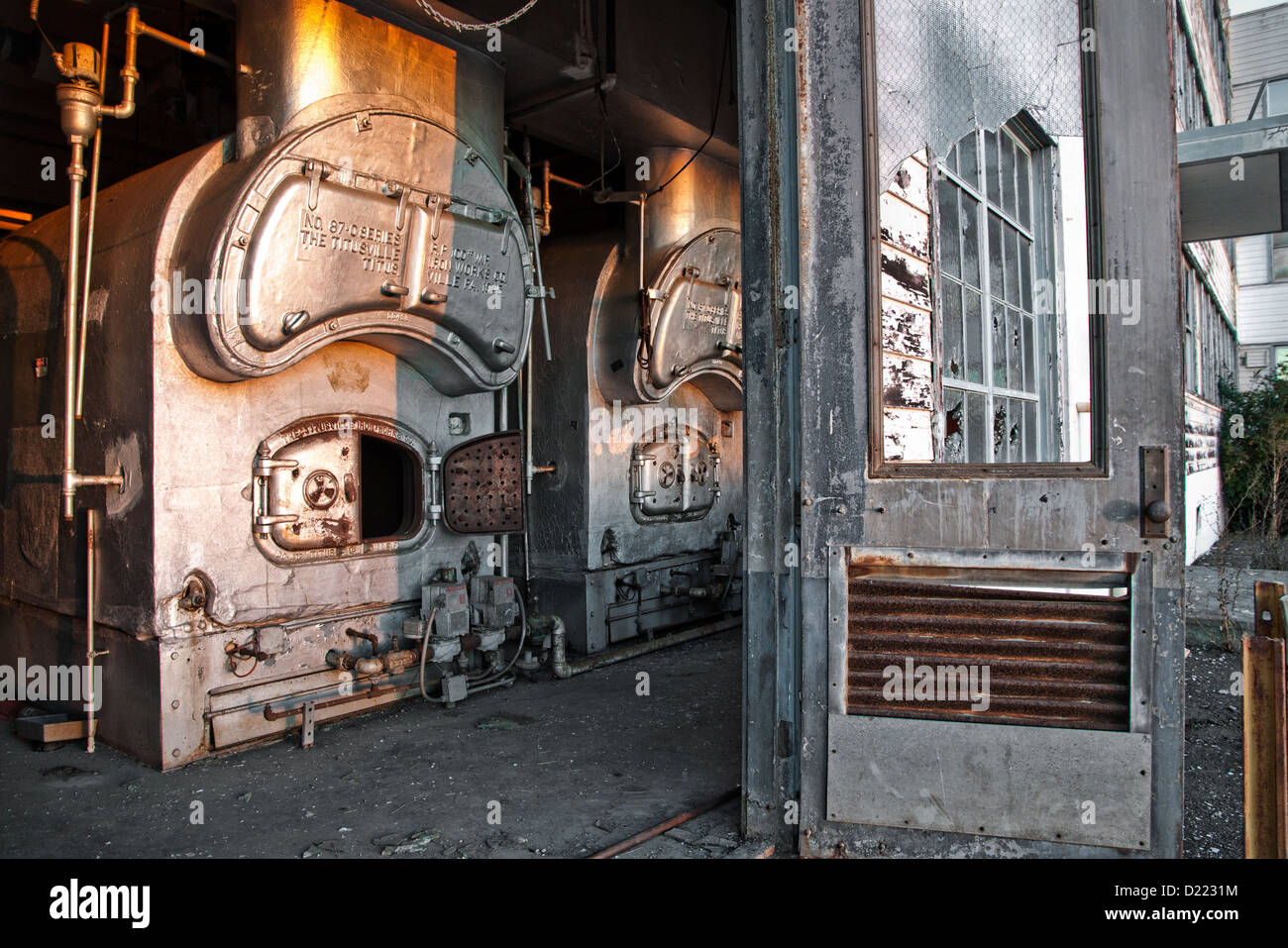 Open door leads to vintage boiler amid broken windows at the Mare Island Naval Shipyard. & Open door leads to vintage boiler amid broken windows at the Mare ...