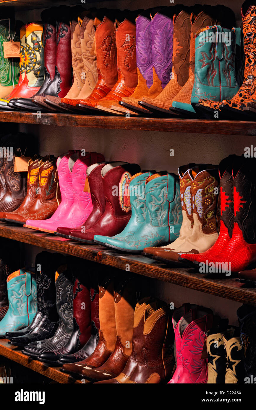 Western boots for sale in a shop- 'Boots Boogie', Santa Fe, New Mexico, USA - Stock Image