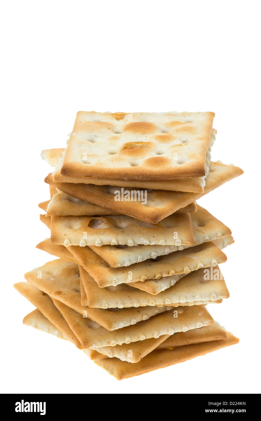 A stack of crispy cracker biscuits - studio shot with a white background - Stock Image