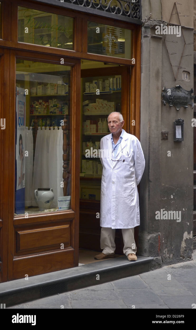 Portrait of a pharmacist in Lucca, Italy standing outside his shop.pensioner, entranceway, front door, chemist, Stock Photo